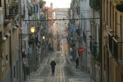 Elevador. Rails in front of row houses in lisbon Stock Photography