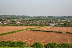 English Countryside overlooking a ploughed field and the Village of Gotham towards East Leake, Nottingham, Nottinghamshire, UK stock photography