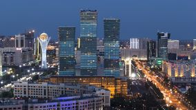 Elevated view over the city center and central business district day to night Timelapse, Central Asia, Kazakhstan. Elevated aerial view over the city center and stock video footage