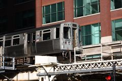 Elevated commuter train in City of Chicago Royalty Free Stock Photo