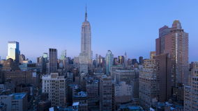 Elevated dusk to night view towards the empire state building midtown manha stock video footage