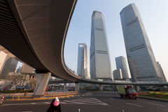 Elevated expressway in city. Looking up at an elevated expressway passing over main roads and a roundabout in the Pudong area of Shanghai, China Stock Photo
