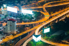 Elevated expressway and cityscape at night Stock Photos