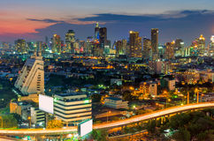 Elevated expressway. Landscape building modern business district of Bangkok. Expressway in the foreground at twilight Royalty Free Stock Photo