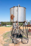 Elevated Fuel Tank. With silver barrel shape, nozzle, hose and ladder in Western Australia farmland Stock Photography