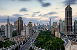 Windy and pinky Shanghai during the sunset. The elevated highway leading to the Shanghai Lujiazui financial center during the sunset period Stock Images