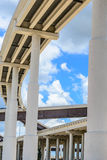 Elevated highway. Upward view of Elevated highway with blue sky and clouds Royalty Free Stock Photo
