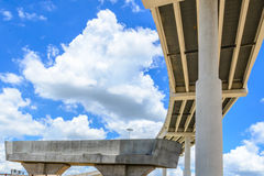 Elevated highway. Upward view of Elevated highway with blue sky and clouds Royalty Free Stock Image