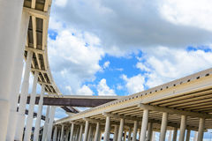 Elevated highway. Upward view of Elevated highway with blue sky and clouds Stock Photo