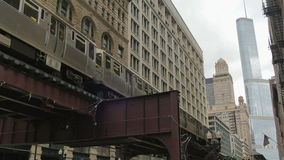 Elevated Metro in Chicago Loop Financial District. Cta trains running on elevated tracks of Metro Chicago stock video