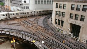 Elevated Metro in Chicago Loop Financial District. Cta trains running on elevated tracks of Metro Chicago stock video footage