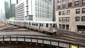 Elevated Metro in Chicago Loop Financial District. Cta trains running on elevated tracks of Metro Chicago stock footage