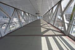 Elevated pedestrian skywalk between buildings Stock Images
