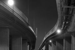 Elevated road. Low angle view of elevated road in black and white at night Royalty Free Stock Photo