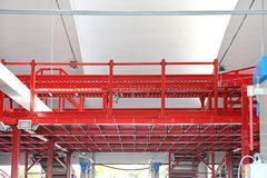 Elevated Conveyor Transport. Elevated Shipping Conveyor in Distribution Warehouse Stock Photo