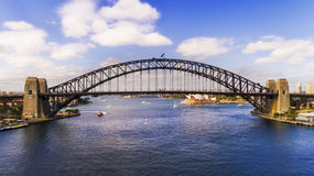 DJI Sy Br Arch Side Day. Elevated side view of the Sydney Harbour bridge connecting shores of Sydney harbour on a sunny day from above water Stock Image