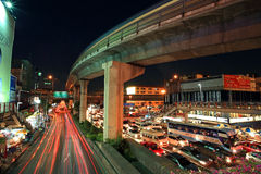 Elevated sky train railway above road with light trails Stock Images