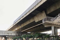 Elevated Super highway junction cross over structure. Elevated Super highway junction cross over structure with express way straddle the city traffic below Stock Image