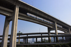 Elevated train Bridges and overpasses. Mixed traffic system Royalty Free Stock Photos