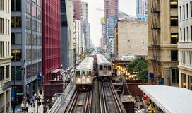 Elevated Train Tracks above the streets and between buildings at The Loop August 3rd, 2017 - Chicago, Illinois. USA Royalty Free Stock Image
