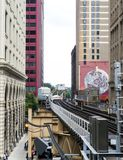 Elevated Train Tracks above the streets and between buildings at The Loop August 3rd, 2017 - Chicago, Illinois. USA Stock Image