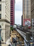 Elevated Train Tracks above the streets and between buildings at The Loop August 3rd, 2017 - Chicago, Illinois. USA Royalty Free Stock Photos