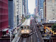 Elevated Train Tracks above the streets and between buildings at The Loop August 3rd, 2017 - Chicago, Illinois. USA Stock Photo