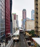 Elevated Train Tracks above the streets and between buildings at The Loop August 3rd, 2017 - Chicago, Illinois. USA Stock Photography