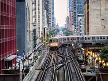 Elevated Train Tracks above the streets and between buildings at The Loop August 3rd, 2017 - Chicago, Illinois. USA Royalty Free Stock Photo