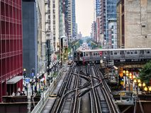 Elevated Train Tracks above the streets and between buildings at The Loop August 3rd, 2017 - Chicago, Illinois. USA Royalty Free Stock Photography