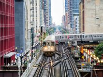 Elevated Train Tracks above the streets and between buildings at The Loop August 3rd, 2017 - Chicago, Illinois. USA Stock Images