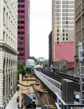 Elevated Train Tracks above the streets and between buildings at The Loop - Chicago, Illinois. USA Royalty Free Stock Photo