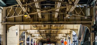 Elevated Train Tracks above the streets and between buildings at The Loop - Chicago, Illinois Royalty Free Stock Photo