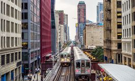 Elevated Train Tracks above the streets and between buildings at The Loop - Chicago, Illinois. USA Stock Photography