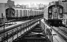Elevated Trains. View of an uptown and downtown elevated subway trains Stock Image