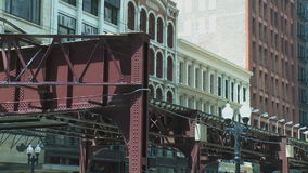 Elevated trains cross paths in Chicago. Chicago's elevated train system.  Similar to other cities subway system stock video footage