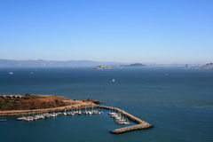 Elevated View of Alcatraz and San Francisco Bay. Sailboats and blue skies show in this beautiful day Stock Images