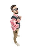 Elevated view of bearded young hipster holding suspenders. Stock Image