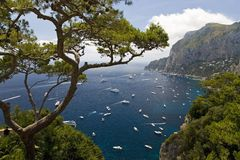 Elevated view of blue waters of the City of Capri, an Italian island off the Sorrentine Peninsula on the south side of Gulf of Nap. Les, in the region of stock image