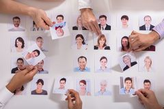 Group Of Businesspeople Selecting Candidate Photo royalty free stock photography