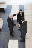 Elevated view of businesspeople shaking hands. Stock Images