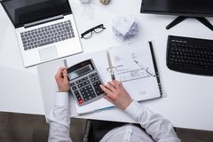 Elevated View Of Businessperson Calculating Invoice royalty free stock images
