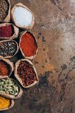 elevated view of colorful spices in paper bags royalty free stock photography