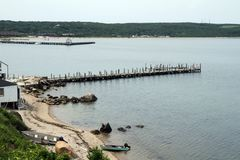 Montauk Travel. An elevated view of the dock and Fort Pond Bay in Montauk, NY Stock Photography