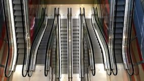 Elevated view of empty moving staircase running up and down. Modern escalator stairs, which moves indoor stock video