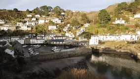 Elevated view of English harbour Polperro Cornwall South West England UK professional video pan stock video