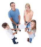 Elevated View Of Family Holding Blank Paper royalty free stock image