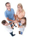 Elevated View Of Family Putting Hands Together Stock Photo