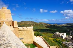 Countryside seen from the citadel, Victoria, Gozo. Elevated view of fortified buildings and the landscaped old moat within the citadel with views towards the Stock Image
