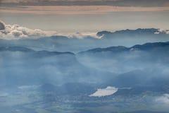 Sunny autumn panorama of hazy Lake Bled in Slovenia Royalty Free Stock Image